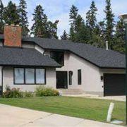 exterior of grey and black house in red deer alberta new custom home renovation custom homes red deer