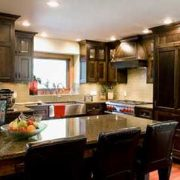 kitchen with grey granite countertops and dark maple wood kitchen cabinets interior kitchen renovations red deer