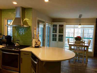 white marble countertop in kitchen with green tile backsplash interior kitchen renovations red deer