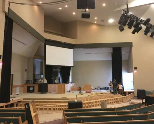 auditorium of church with pews commercial church renovation in red deer