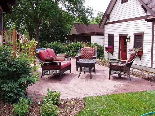 patio and chairs outdoors with green grass