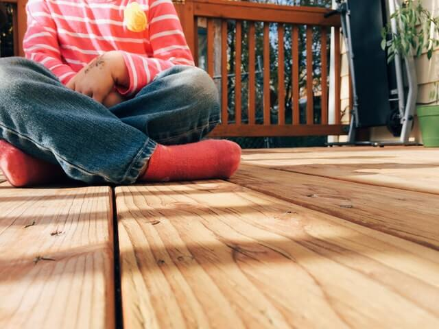 deck-wood-girl-sitting outside-lines