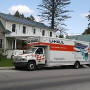 moving van uhaul in front of house during home improvement project