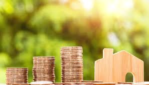 home improvement project coins next to wooden home return on investment roi
