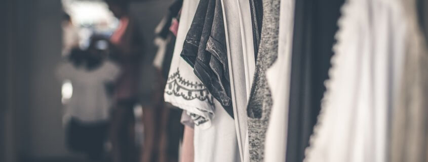 clothes hanging in an organized closet